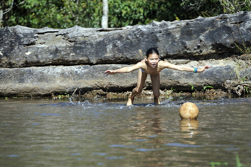 Paraguay, Caaguazu, Cerro Monti, Girl from the Ache Guarani people jumping into river - FLK000047