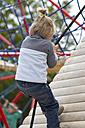 Germany, Schleswig-Holstein, Kiel, little girl climbing upwards - JFE000218