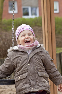 Germany, Schleswig-Holstein, Kiel, portrait of smiling little girl at playground - JFE000205