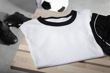 Football shirt, pants and shoes on bench, studio shot - PDF000430