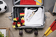 Football shirt , tickets and fan articles packed in suit case, studio shot - PDF000433