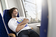 Relaxed man in a train - KFF000242