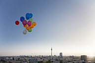 Germany, Berlin, View over city from rooftop terrace with balloons - FKF000258