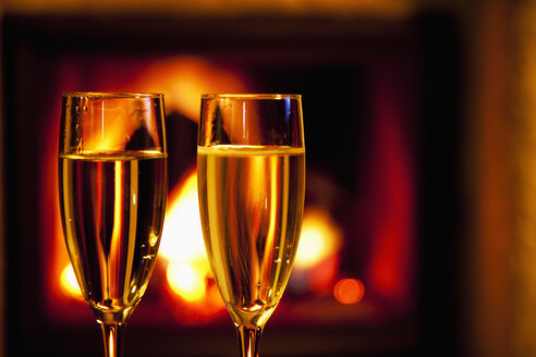 Two glasses of champagne at the fireplace - CSF020032