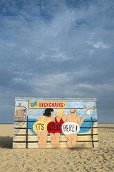 United Kingdom, England, Great Yarmouth, Painted wooden hut on beach - EL000465