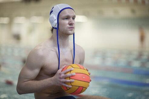 Water polo player outside pool holding ball - SEF000067