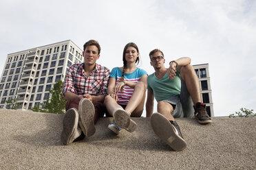 Germany, Bavaria, Munich, Friends sitting outdoors - RBF001363