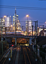 Germany, Hesse, Frankfurt, Tilt-shift view of central station with financial district in background - AM000929
