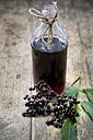 Elderberry juice and elderberries on a wooden table - LVF000208