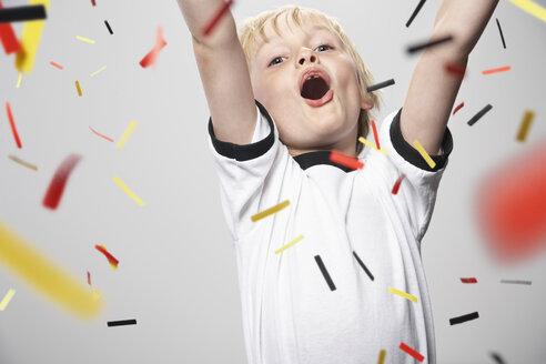 Boy in soccer jersey cheering - PDF000472