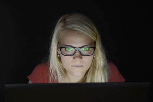 Young woman using laptop by night - BFRF000307
