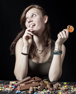 Teenage girl with lollipop and sweets - DIS000092