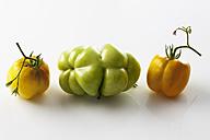 Three yellow pepper tomatoes, studio shot - CSF020113