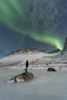 Norway, Province Troms, View of Aurora Borealis and a man - PA000042