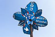 Germany, Munich, flower sculpture, old traffic signs during Tollwood Festifal - TC003588