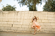 Malta, San Gwann, young woman posing in front of a stone wall - SPCF000003