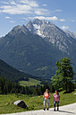 Germany, Bavaria, Hikers on Ramsau mountain pasture experience path - LB000370