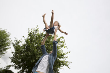 Father playing with his little daughter in the garden - JATF000436