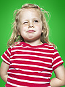 Portrait of twinkling little girl, studio shot - STKF000372