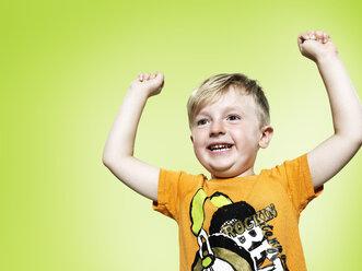 Portrait of proud little boy, studio shot - STKF000375