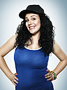 Portrait of a smiling young woman with basecap, studio shot - STKF000384