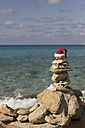 Spain, Balearic Islands, Formentera, Christmas cap at beach - CMF000007