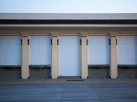 France, Normandy, Deauville, Boardwalk and house with sunblinds - TLF000719