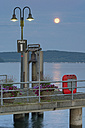 Germany, Baden-Wurttenberg, Lake Constance. full moon over harbour of Unteruhldingen - SH000854