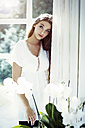 Teenage girl standing at window - GDF000242