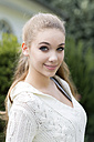 Portrait of teenage girl with ponytail hairstyle - GDF000278
