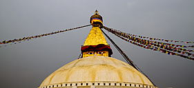 Nepal, Kathmandu, Bodnath, Stupa sanctuary with prayer flags - MBE000816