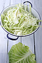 Pointed cabbage on wooden table - ODF000604