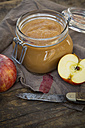 Apple puree in bottling jar and apples on wooden table - LV000273
