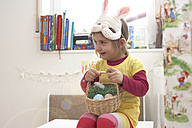 Smiling little girl with Eastern nest and bunny mask - FS000321