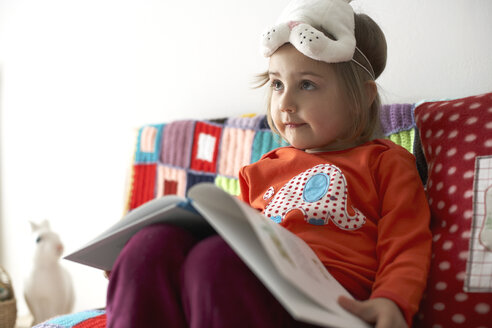 Portrait of little girl with bunny mask and opened book on her knees - FS000325