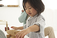 Little Asian girl playing with her wooden toy - FSF000065