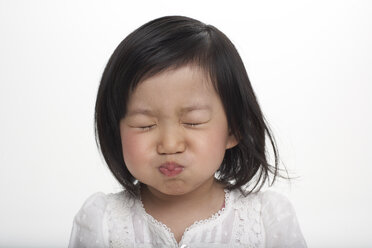 Little Asian girl holding breath, studio shot - FSF000083