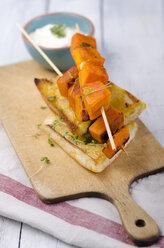 Pumpkin skewers on roasted bread with dip - ODF000614