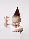 Angry baby wearing party hat - FSF000062