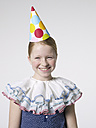 Smiling girl wearing party hat - FSF000050