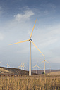 Spain, Andalusia, Cadiz, wind turbines standing on a field - KB000002