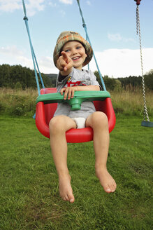 Little boy swinging in the garden - RDF001210
