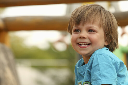 Portrait of smiling little boy at playground - RDF001227