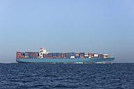 Spain, Andalusia, Tarifa, Cargo ship on the ocean - KB000025