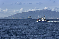 Spain, Andalusia, Tarifa, Oil tanker and Spanish fishing boat on the ocean - KB000027