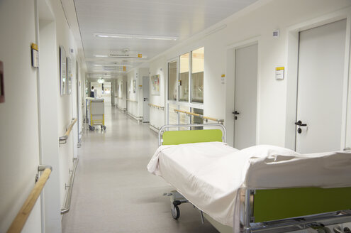 Germany, Freiburg, View of bed in empty hospital corridor - DHL000133