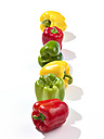 Row of red, green and yellow bell peppers - SRSF000338