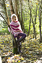 Germany, Vilsbiburg, Girl in forest, wearing poncho - STB000117
