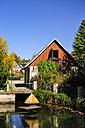 Germany, Saxony, Hinterhermsdorf, House at a pond - BT000210