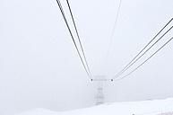 Switzerland, Arosa, Cable car in fog - AWDF000702